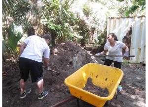 Jared and Leah digging up soil for planting